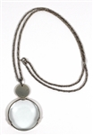 Madonna Owned and Re-Gifted A sterling silver Tiffany Monacle Magnifier on woven neck chain, 1989